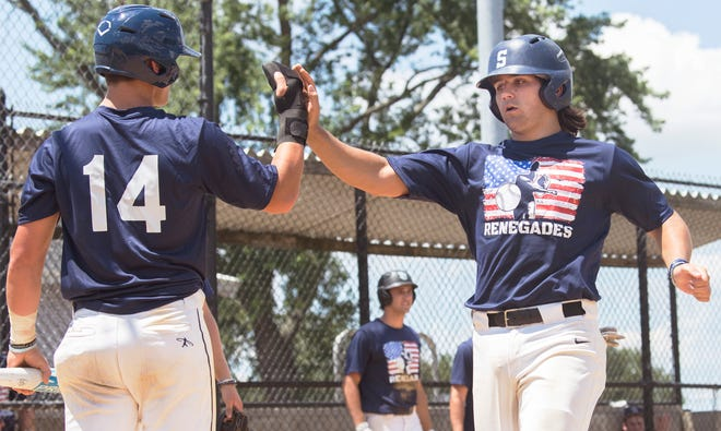 Medford's Cole Fleming, right, is congratulated by Medford's Max Kaufer after Fleming scored a run during the Last Dance baseball tournament game between Medford and Pine Hill played in Bellmawr, NJ, on Tuesday, July 14, 2020.   Medford defeated Pine Hill, 13-3 in 6 innings.