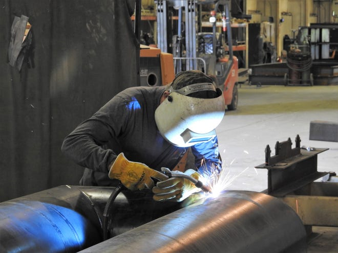 Greg Michael welds a burner tube together at Crozier Welding. The business started in 1980 recently moved to a new location on Ohio 83. The move is projected to lead to 15 to 25 new jobs and an investment of $2.5 million. They make equipment for the oil and gas industry.