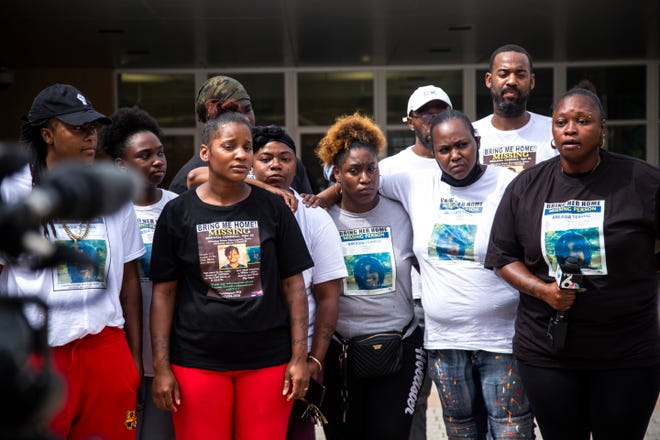 Aishia Lankford, mother of missing 10-year-old girl Breasia Terrell, (third from left) listens as Lueritha McGowan, far right, speaks to reporters with a group of a family members, Tuesday, July 14, 2020, outside the Davenport Police Department in Davenport, Iowa.