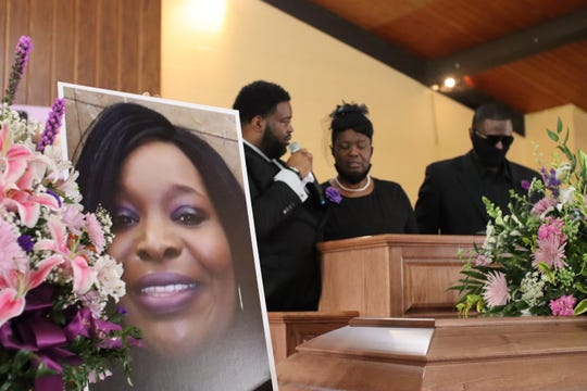 From left to right, Gene Latimore, Marquetta Latimore, and John Terry speak at Geanell Latimore's funeral.