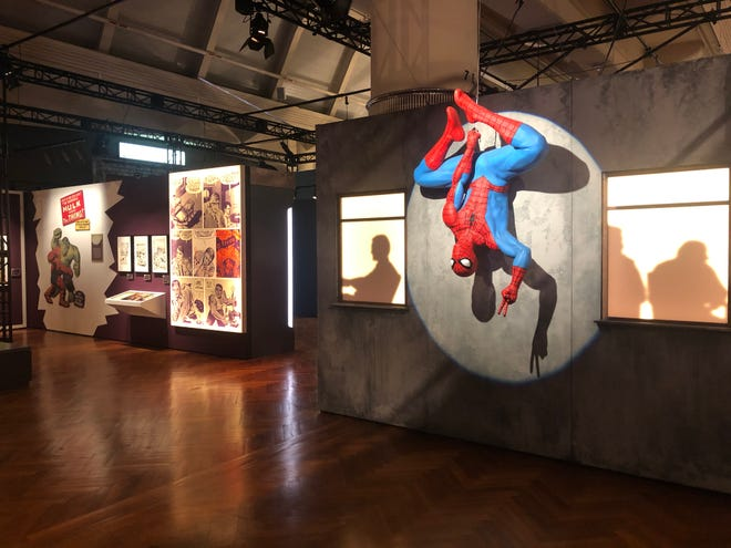 Spider-Man hangs out in a characteristic pose at the 'Marvel: Universe of Super Heroes' exhibition opening July 16, 2020 at the Henry Ford Museum in Dearborn.