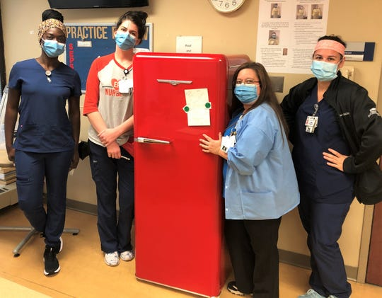 Health care workers at Harper Hospital post with their new Northstar refrigerator, donated to the hospital in late June by Elmira Stove Works.