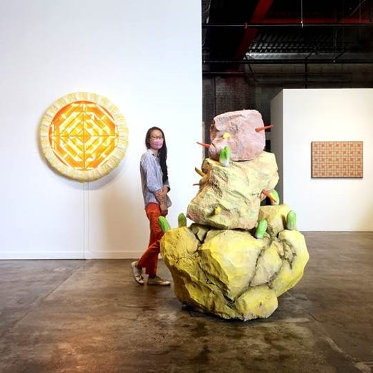 Wasserman Project curator and director Alison Wong clad in mask amongst sculptural elements of artist Adrian Wong's current exhibition, showing concurrently with Steve and Dorota Coy's show.