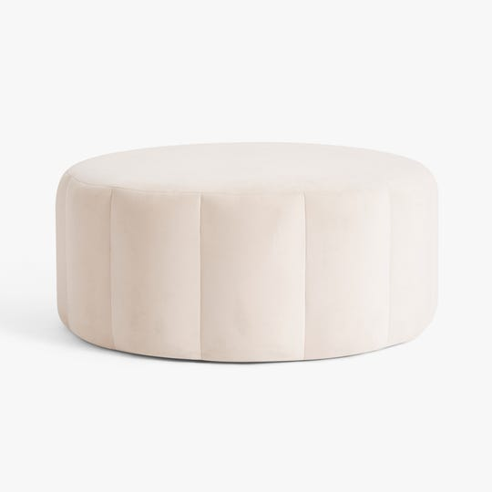 The Channel Stitch Ottoman is part of the new Monique Lhuillier collection with Pottery Barn Teen.