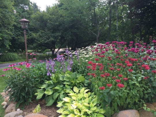 """At least seven gardens will be featured on this year's """"No Frills Garden Stroll"""" hosted by the Rochester Garden Club."""
