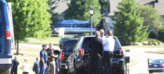 Police at the scene of a deputy-involved shooting Tuesday, July 14, 2020 on Jerryson Drive near Dickson Drive in Grand Ledge, Mich.