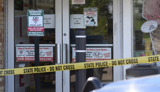 The scene where a 77-year-old man was stabbed by a 43-year-old man Tuesday morning outside of a Quality Dairy on Lansing Road in Windsor Township.