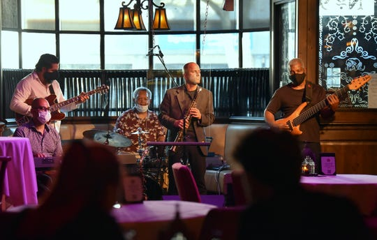 Playing (from left) keyboards Derrick Benford of Detroit, guitarist Matt Callaway of Monroe, drummer and band founder Gene Dunlap of Southfield, saxophonist Nick Stone of Dearborn and bassist Carl Holmes of Detroit perform at The Dirty Dog Jazz Cafe in Grosse Pointe Farms on Thursday, July 9, 2020.