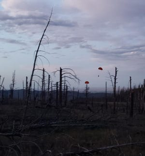 Smoke jumpers land in the area of the Stratton Park Fire on July 13, 2020. Crews expect to have the 4-acre fire near the lower Poudre Canyon contained by Tuesday.