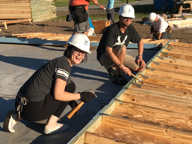 "Part of the agreement with Habitat for Humanity for new home owners is to invest ""sweat equity"" into the building of their new home, which is what Amber Wellsted was doing in this photo."