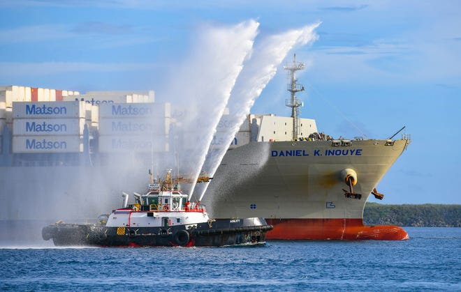 Matson's Daniel K. Inouye containership gets a water salute by Cabras Marine tugboats after entering Apra Harbor during its inaugural voyage to Guam in this July 14 file photo.