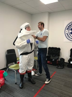 Johnson County Ambulance paramedics Dan Powers and Tom Otskey perform training with CAPRs, or Controlled air purifying respirators, May 20, 2020 at the agency's headquarters in Iowa City.