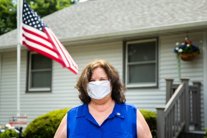 Diana Broderson, mayor of Muscatine, Iowa, poses for a photo while wearing a face mask amid the novel coronavirus pandemic, Tuesday, July 14, 2020, in Muscatine, Iowa.