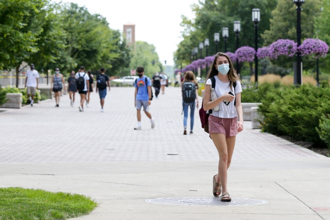 Students walk across the Centennial Mall at Purdue University, Tuesday, July 14, 2020 in West Lafayette.