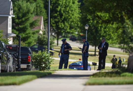Michigan State Police and a member of the Eaton County Sheriff at the scene of a deputy-involved shooting in the 11000 block of Jerryson Drive in Delta Township on Tuesday, July 14, 2020.