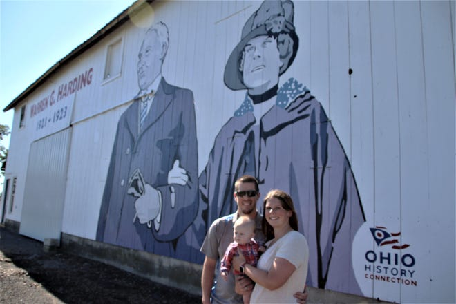 Jason and Emma Nutbrown pose in front of a mural of President Warren G. Harding and First Lady Florence Harding that is located on the side of a barn on their property along Ohio 95 in Claridon Township. The mural, painted by Ohio bicentennial barn artist Scott Hagan, was unveiled on Saturday, July 11, 2020. It was commissioned by the Ohio History Connection and is part of the Ohio History Barn project. The Nutbrowns said they are proud to have the Harding mural located on their property.