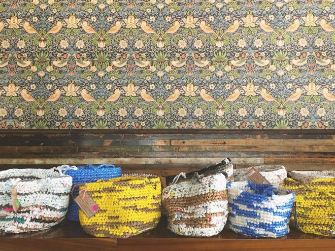 The GK Picnic & Provisions Community Baskets are colorful baskets crocheted by former refugee women from the Democratic Republic of the Congo. Goodkind restaurant fills them with picnic food and sells them.