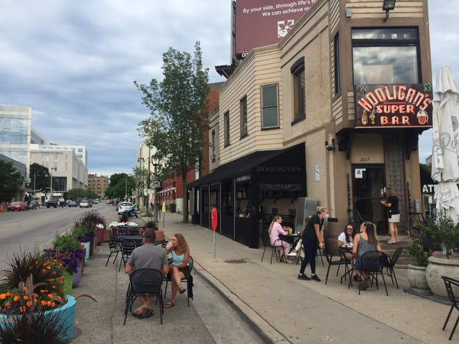 Hooligan's is among the Milwaukee restaurants that are using a new city program to expand outdoor dining space into streets.