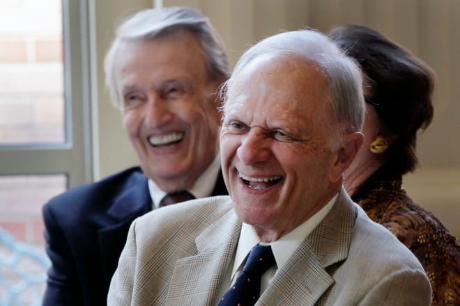 Former U.S. Senators David Pryor (foreground) and Dale Bumpers (background) laugh at a joke during a meeting Sept. 18, 2013 at the Governor's mansion in Little Rock. Pryor, a former Arkansas governor and U.S. senator, has been hospitalized after testing positive for the virus that causes COVID-19, his family said in a statement.