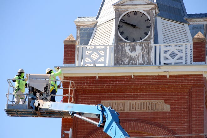 Workers for Mooring Construction out of Albuquerque spent many hours high above the Luna County Courthouse during the firm's restoration. the project took four weeks and included repairs, replacing rotted wood piece and a fresh coat of paint. The iconic clock also needed work and is fully operational.