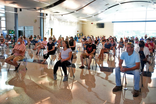 About 100 parents and community members take part in Spring Grove Area School District school board meeting, many voicing their concerns over plans for return to school amid the pandemic. Monday, July 13, 2020.