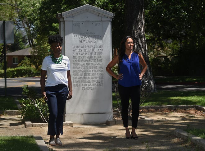 Khalilah Cage, left, and Bin Bin Erwin stand in front of the Francis Griffith Newlands monument at the Newlands Park in Reno, Nevada on July 14, 2020.