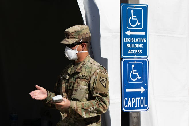 The National Guard checks temperatures of those entering the Nevada State Legislature Building on the fifth day of the 31st Special Session in Carson City, Nev., on Monday, July 13, 2020. (Trevor Bexon/Nevada Independent)