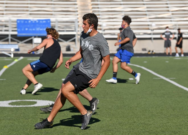 The McQueen high football team practices early in the morning on Tuesday July 14, 2020.