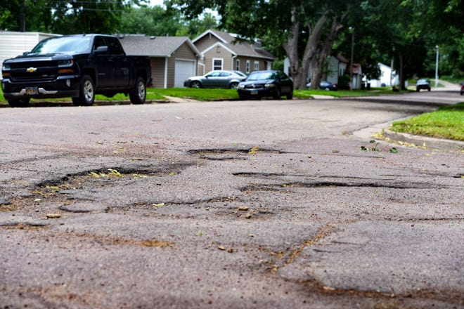 Potholes break up an intersection on Tuesday, July 14, on W 27th Street in Sioux Falls.