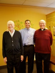 Mark Roerick poses for a picture with Rev. Nick and Rev. Bob Landsberger.