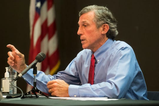 Gov. John Carney speaks to the media during a briefing on the status of the coronavirus pandemic in Delaware on Tuesday, July 14, 2020, at the Carvel State Office Building in Wilmington.