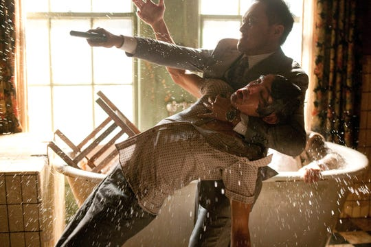 """Saito (Ken Watanabe) holds an enemy (Lucas Haas) during a gunfight in """"Inception."""""""