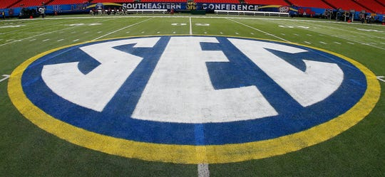 SEC logo is displayed on the field ahead of the Southeastern Conference championship game.