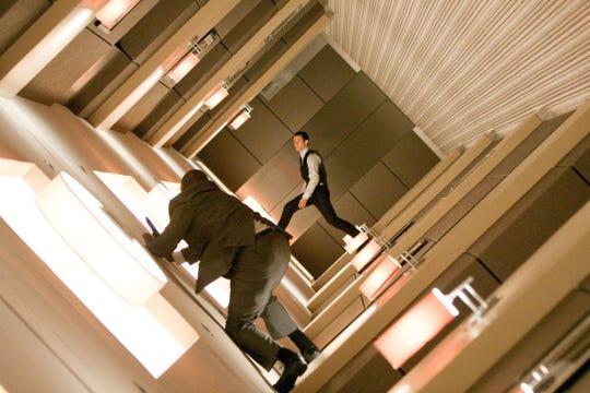 "Arthur (Joseph Gordon-Levitt, center) avoids a bad guy as reality rotates around him in ""Inception."""