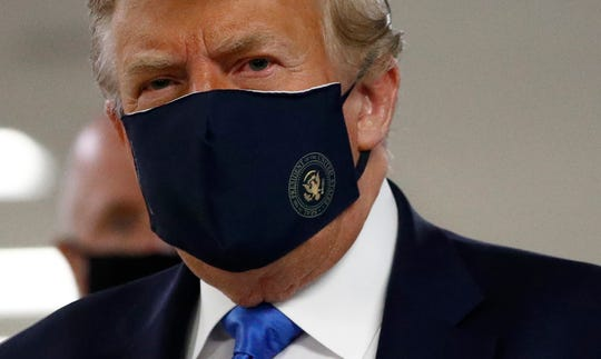 President Donald Trump wears a face mask as he visits Walter Reed National Military Medical Center in Bethesda, Md., July 11, 2020.