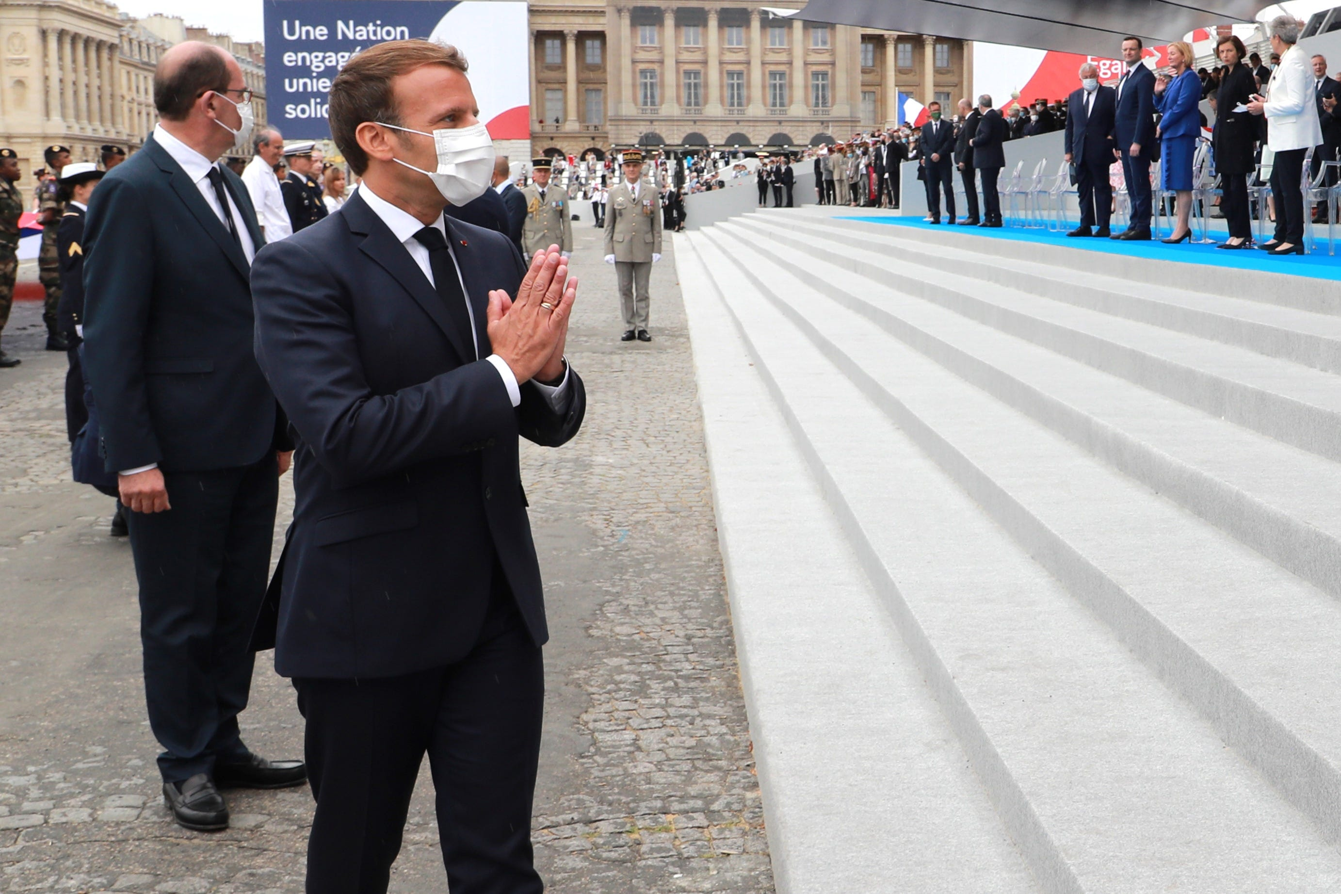 Macron says France will begin lifting restrictions in May for vaccinated travelers