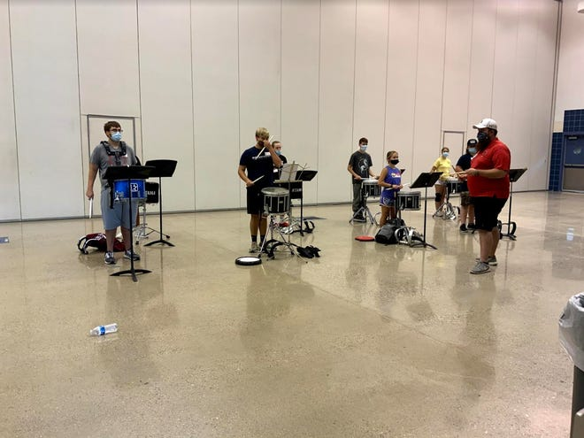 Snare drummers prepare for more exercises during the 2020 Texoma Marching Arts and Leadership Academy in Ardmore on Wednesday.