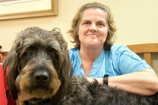 Brutus and Sharon Conley are one of about 30 pet therapy teams at Bayhealth.