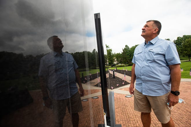Retired FDNY battalion chief John Salka looks up at the American flag at the 9/11 memorial at Firefighters Memorial Park in Washingtonville on Wednesday.
