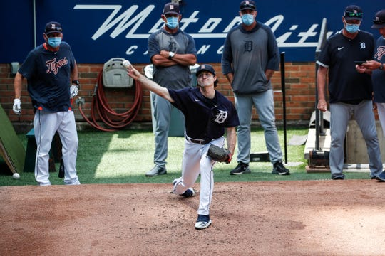 Detroit Tigers pitcher Casey Mize warms up in the bullpen during summer camp at Comerica Park in Detroit, Tuesday, July 14, 2020.
