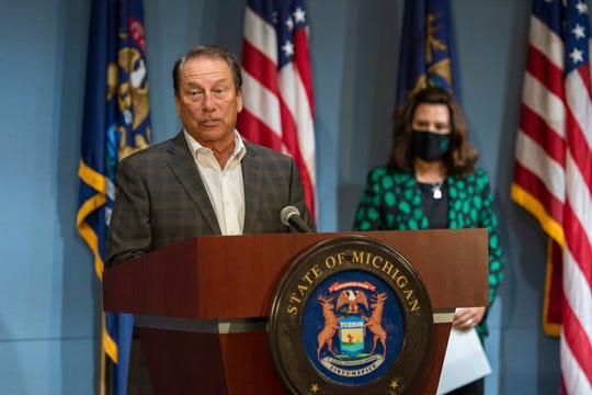 Michigan State University basketball coach Tom Izzo, along with Gov. Gretchen Whitmer, right, urges Michigan residents to wear masks in public.