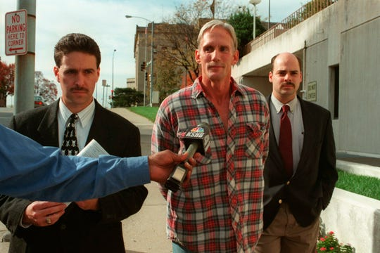 In this 1998 photo, Wesley Ira Purkey, center, is escorted by police officers in Kansas City, Kan., after he was arrested in connection with the death of 80-year-old Mary Ruth Bales. Purkey was also convicted of kidnapping and killing a 16-year-old girl.