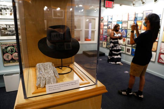 Michael Jackson's black Fedora and glove are displayed at the Motown Museum, Wednesday, July 15, 2020.