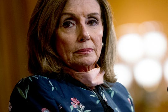 """House Speaker Nancy Pelosi of Calif., pauses during a news conference on Capitol Hill in Washington, Wednesday, July 15, 2020, to mark two months since House passage of """"The Heroes Act"""" or the Health and Economic Recovery Omnibus Emergency Solutions Act."""