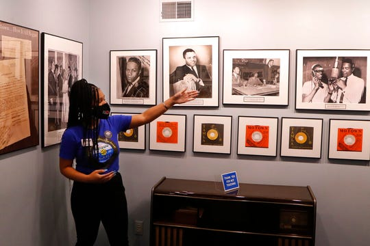Motown Museum tour guide Jamia Henry points out notable Motown legends during a tour of the museum, Wednesday, July 15, 2020.