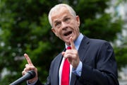 White House trade adviser Peter Navarro speaks with reporters at the White House in this June 18, 2020, file photo. Navarro wrote an op-ed published in USA Today, criticizing Fauci.