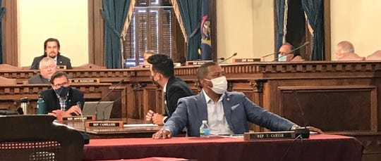 Rep. Tyrone Carter, D-Detroit, wears a mask during a committee hearing inside the Michigan Capitol on Wednesday, July 15, 2020.