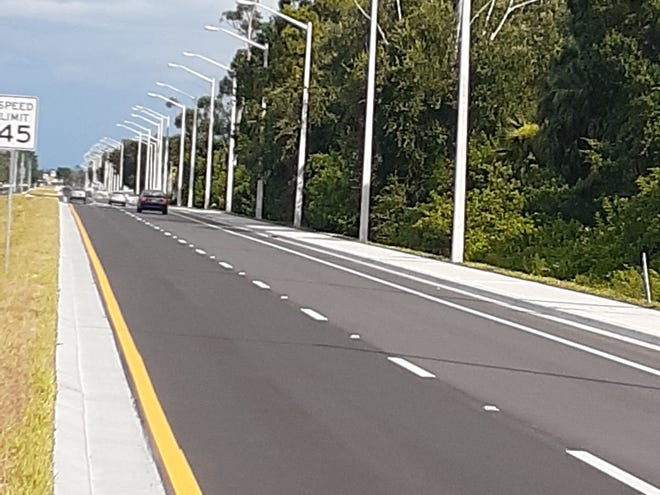 Newly constructed Homestead Road in Lehigh Acres as it passes vacant land.   The new, wider road  is seen as having the potential to spur commercial development needed for growth of the Lehigh community