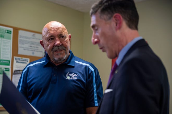 """Executive Director at Aspell Recovery Center, Richard Barber listens to Congressman David Kustoff  give his speech honoring him as the Jackson Exchange Club """"Man of the Year at Aspell Recovery Center in Jackson, Tenn.,  Monday July, 13, 2020."""