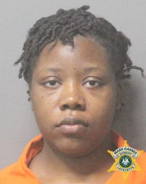 Lafayette Parish Sheriff's Office Corrections Deputy Kayala Baker was arrested during a narcotics sting and has been placed on administrative leave.